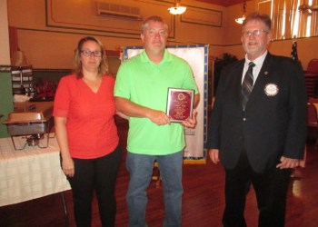Pictured are Jessica and Todd Kling with Cal Thomas, Rotary assistant district governor, who presented the Citizen of the Year plaque. (Provided photo)