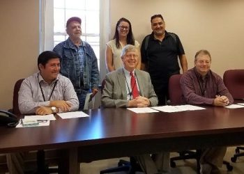 """Clearfield County Commissioners Tony Scotto, John Sobel and Mark McCracken (L-R seated) and Bilger's Rocks Association Members Terry O'Conner, Leslie Buffone, and Dennis Biancuzzo (L-R standing) pose for a photo after the commissioners signed a proclamation declaring September as """"National Recovery Month"""" (Photo by Kimberly Finnigan)"""