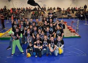 DuBois Area High School students raise their flag in celebration after winning first place in the Penn State DuBois BEST Robotics Competition on Saturday. (Provided photo)