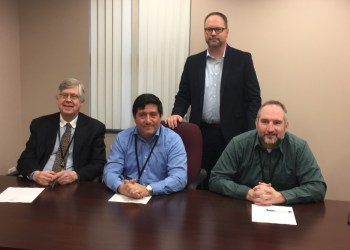 Pictured, in front, are Commissioners John A. Sobel, Tony Scotto, chairman, and Dave Glass. In back is Brad Lashinsky, director North Central PA Launchbox. (Photo by GANT News Editor Jessica Shirey)