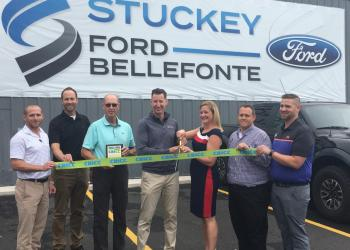 Matt and Tiffany Stuckey cut the CBICC ribbon at their newest location, Stuckey Bellefonte Ford (2892 Benner Pike, Bellefonte, PA 16823), while surrounded by Stuckey employees and Vern Squier, CBICC President & CEO.