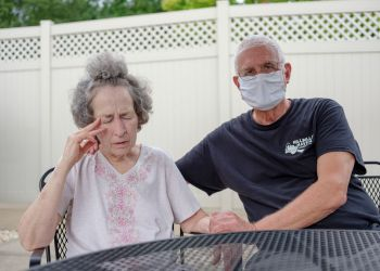 Pat Loughney (right) cared for his wife, Candy, in their home until she went into anaphylactic shock after eating medicated soap. Candy is one of 280,000 Pennsylvanians over the age of 65 living with Alzheimer's disease, the most common cause of dementia.  Quinn Glabicki for Spotlight PA / PublicSource