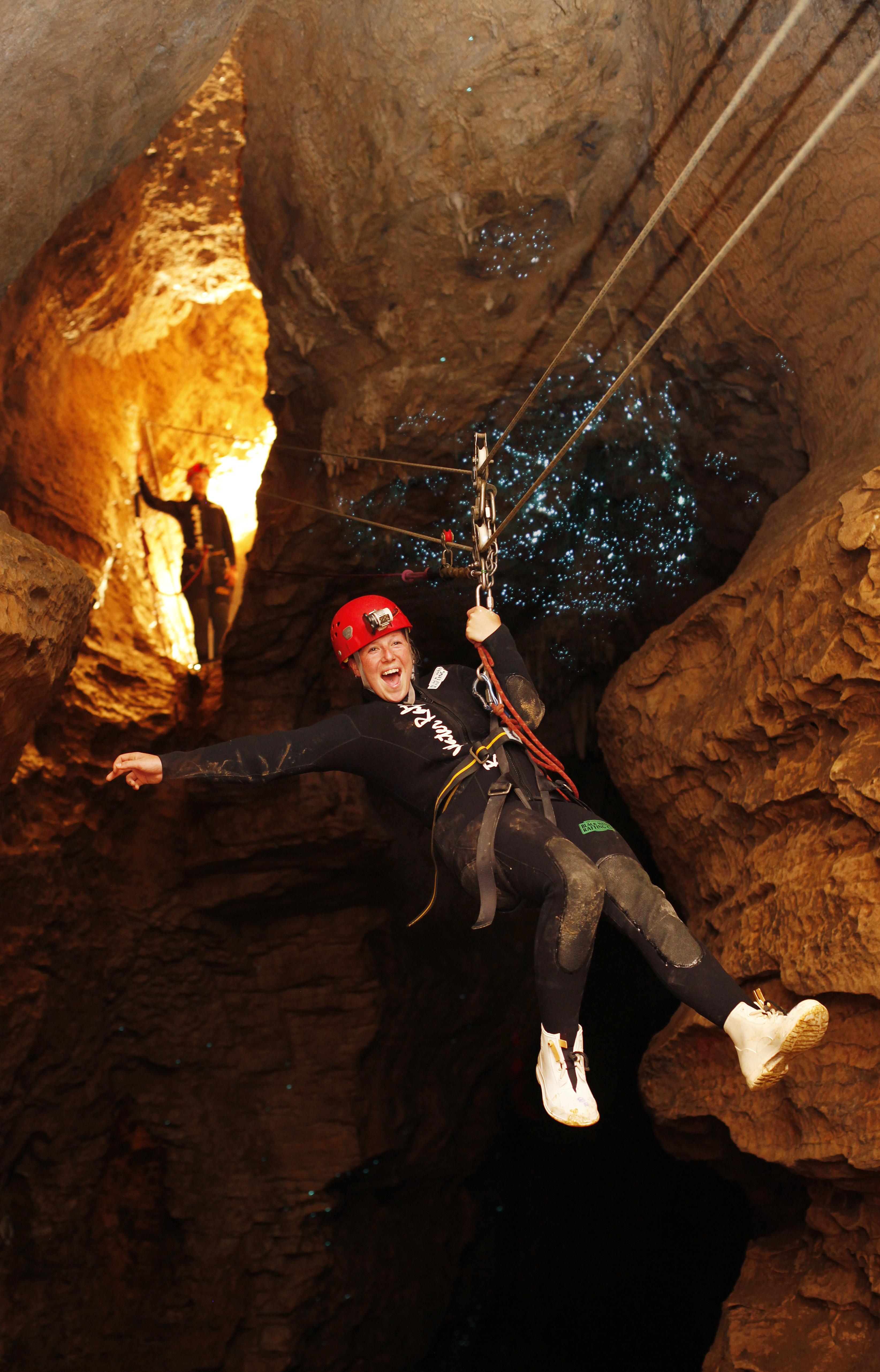Abyss_Girl_Abseiling_Under glowworms