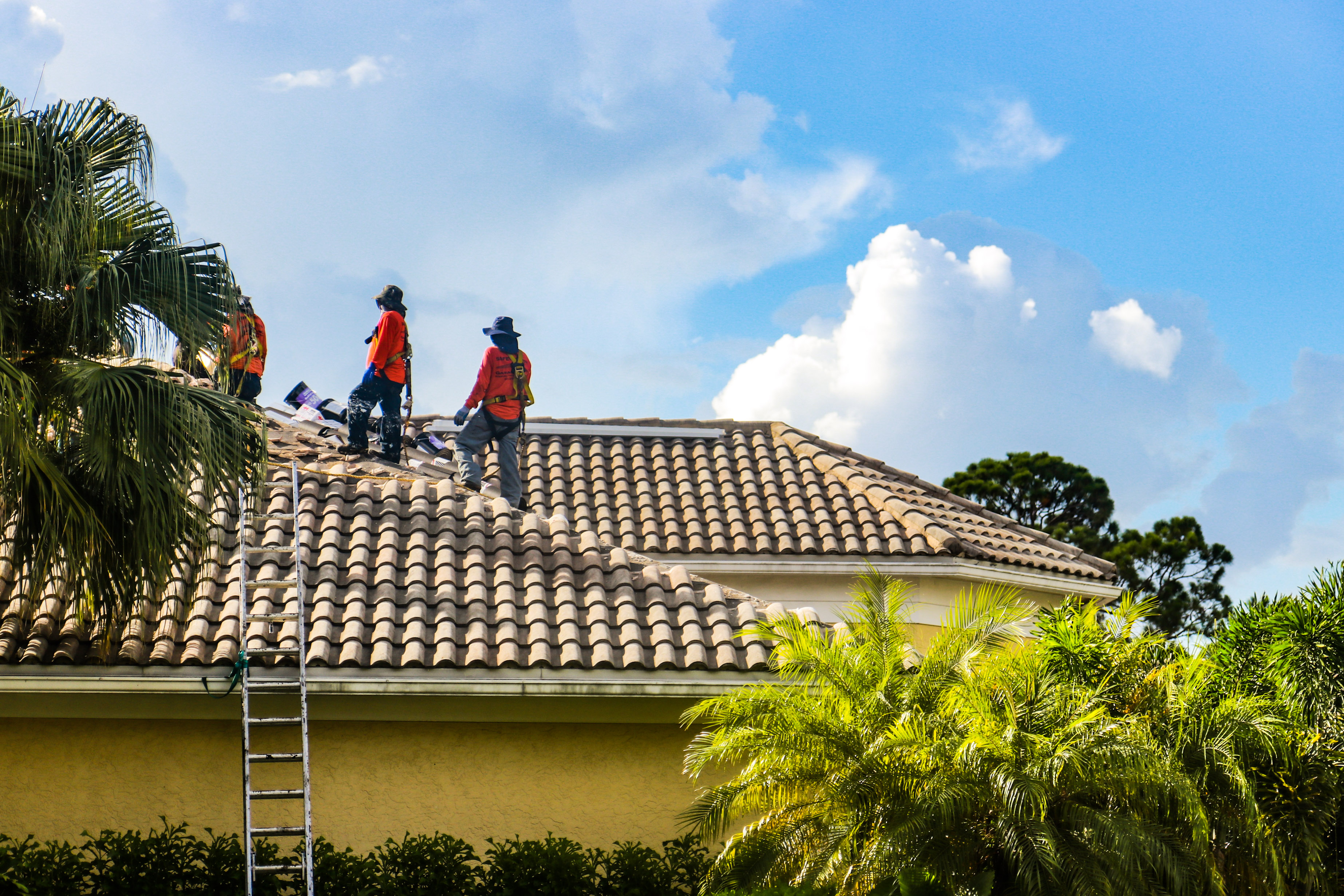 Garabar Roofing Employees on a Roof in Delray Beach Florida