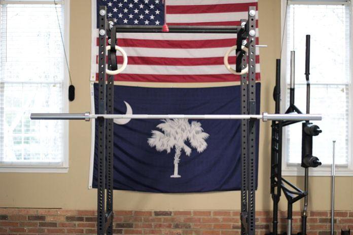 Fringe Sport Power Bar on Power Rack in Garage Gym