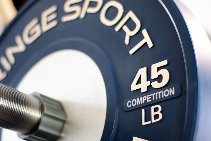 Fringe Sport Competition Bumper Plate Closeup Garage Gym Lab