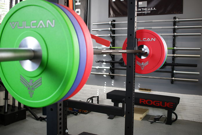 Vulcan Bumper Plates Racked - Garage Gym Lab