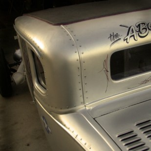 "Pat wanted an aircraft military look to this car. Over 250 ""Fake"" rivets airbrushed on."