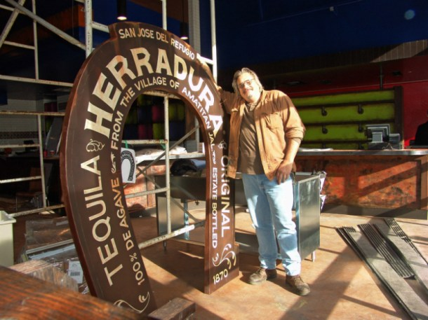 Herradura Tequila horse shoe logo and me. This piece was hand lettered and aged to look old.