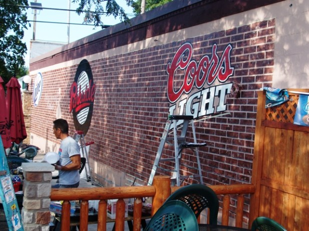 After the brick we added the logos to this outdoor eating area to give this Huntly IL. bar and grille a whole new feel.