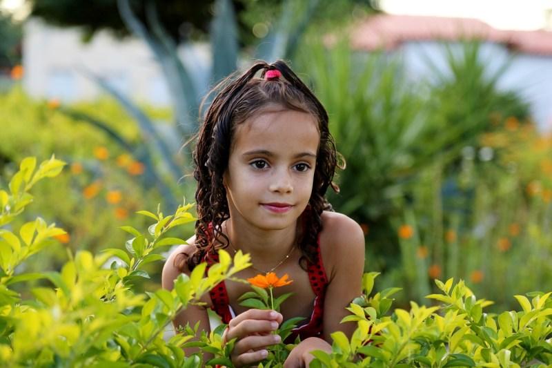 child in a garden