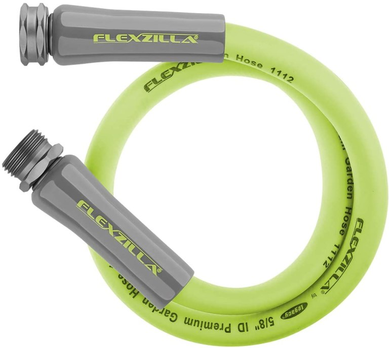 A bright green garden hose lead coiled up with silver connectors on each end.