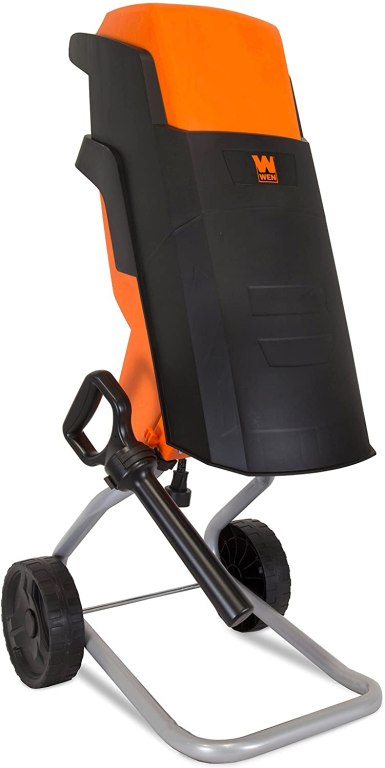 A sleek two-tone black and orange wood chipper with built-in hopper and two wheels.