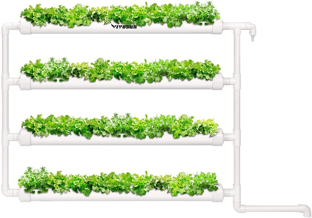 A 4-piece ebb and flow system with lush green plants growing in multiple grow sites.