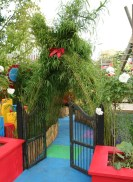 """The low entrance in Adeline's garden says """"kids only"""" (or maybe also those young at heart)"""