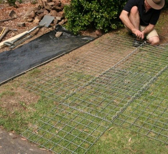 We lay the cage panels out flat to join up the 5 pieces for the base and sides of the bottom cage