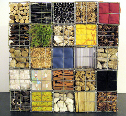 Gabion cages with various fill materials by Natasha Carsberg