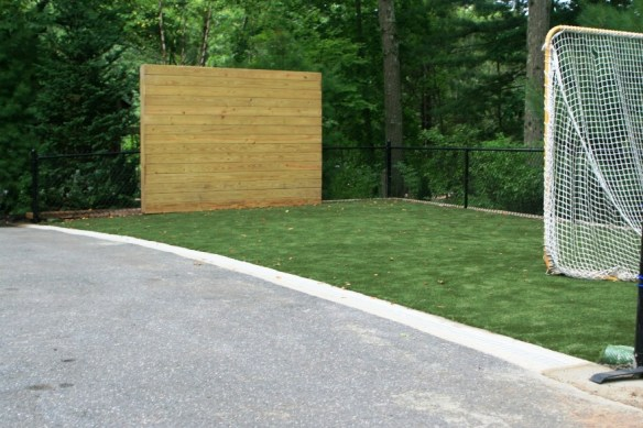 Finished project with almost 1,000 sq ft of new play area and fence to keep balls and kids contained. ©2013 BDG