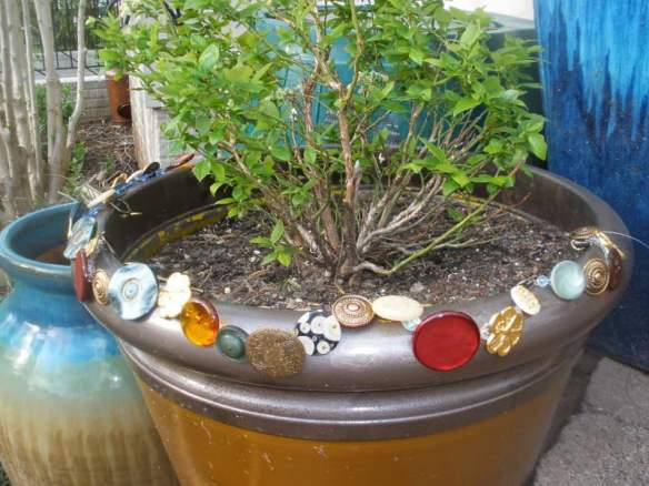button mosaic on old pot
