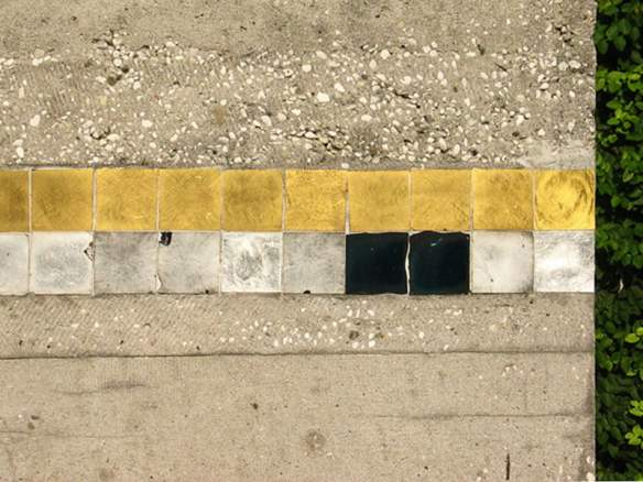 A trail of black, gold and white tiles across 'Latin Influences'
