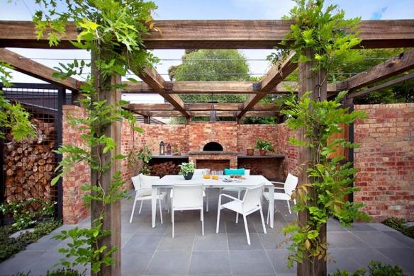 Vine-covered pergola entertaining area with pizza oven Design Ian Barker Gardens