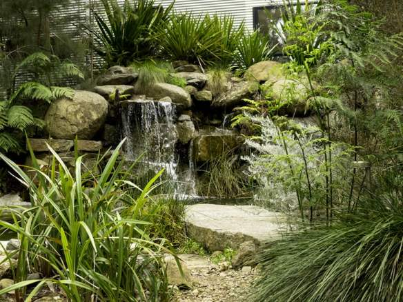 Johnson's stunning waterfall has been designed with secure planting pockets to allow plants to establish. (Anne Vale)