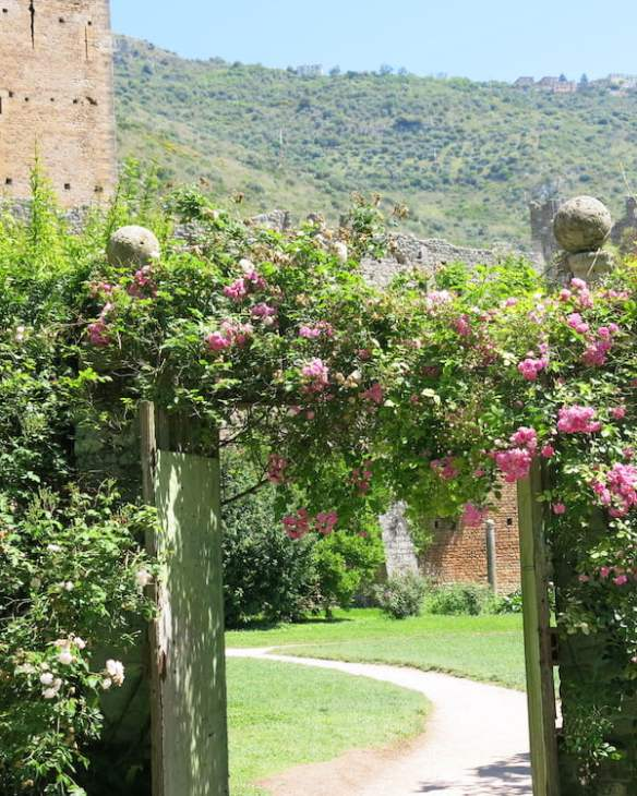 The rose-decked entrance to Ninfa. Photo Deryn Thorpe