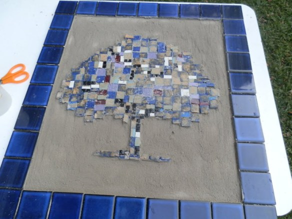Making the tree mosaic for the back of the summer house