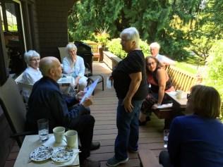 Catherine Lekas talking to Tom Hubka on porch.