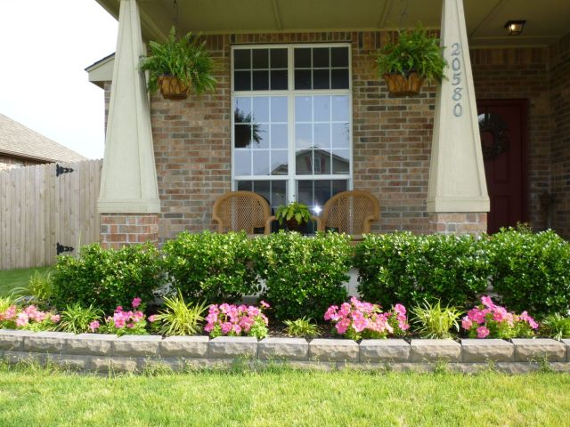 Beautiful landscaping in front of porch
