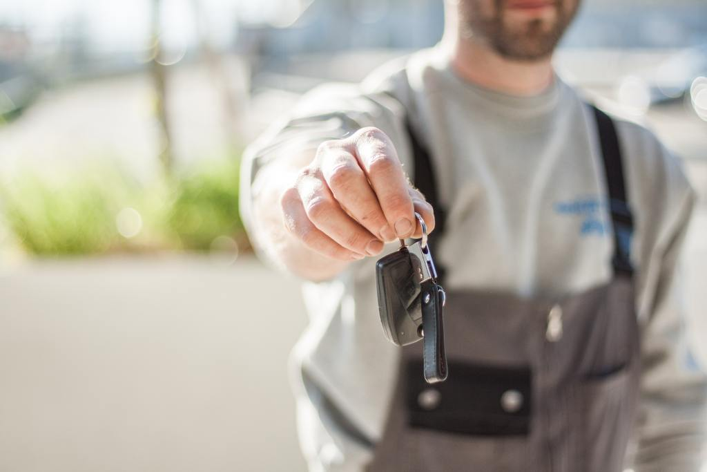 mechanic handing keys to you