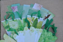 Green bookmarks made from scrap paper and old calendars