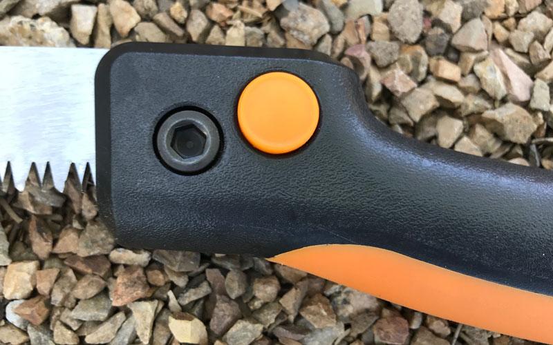 Fiskars-Folding-Hand-Saw-open-close-button