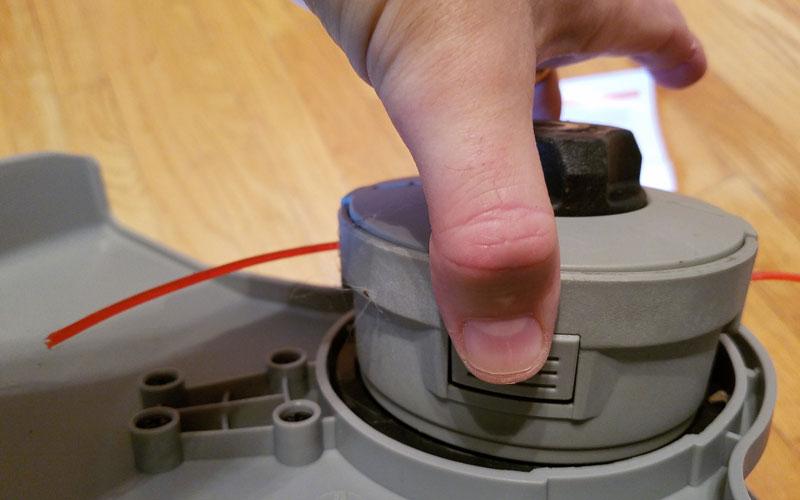 Redback-120v-String-Trimmer-removing-the-string-trimmer-head-19