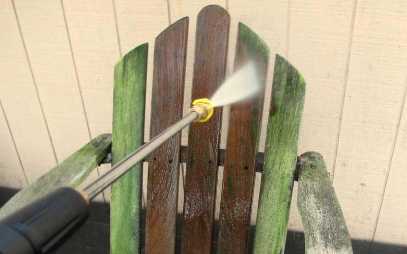 spraying with Sun Joe electric pressure washer