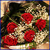 Bouquet of red roses with white baby's breath flowers