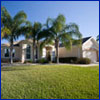 A healthy green Florida-Friendly lawn in front of a stucco home