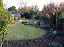 I've been marking out the area around the pond. Now some of the perennials are going in.