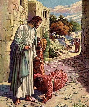 A Samaritan leper worships Jesus after being healed.
