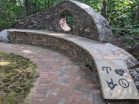 Stonework by Johnny Massengale of Ponders, Inc. This peaceful atmosphere reflects Polly's peaceful spirit. Symbols that represent the things that Polly loved mark the place where she is interred.