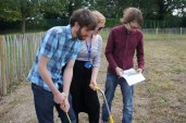 The committee spraying the garden plans onto the soil ready for building work to start
