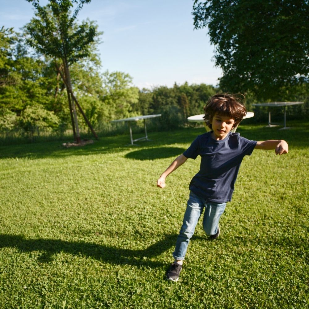 This Kid Walking Across the yard
