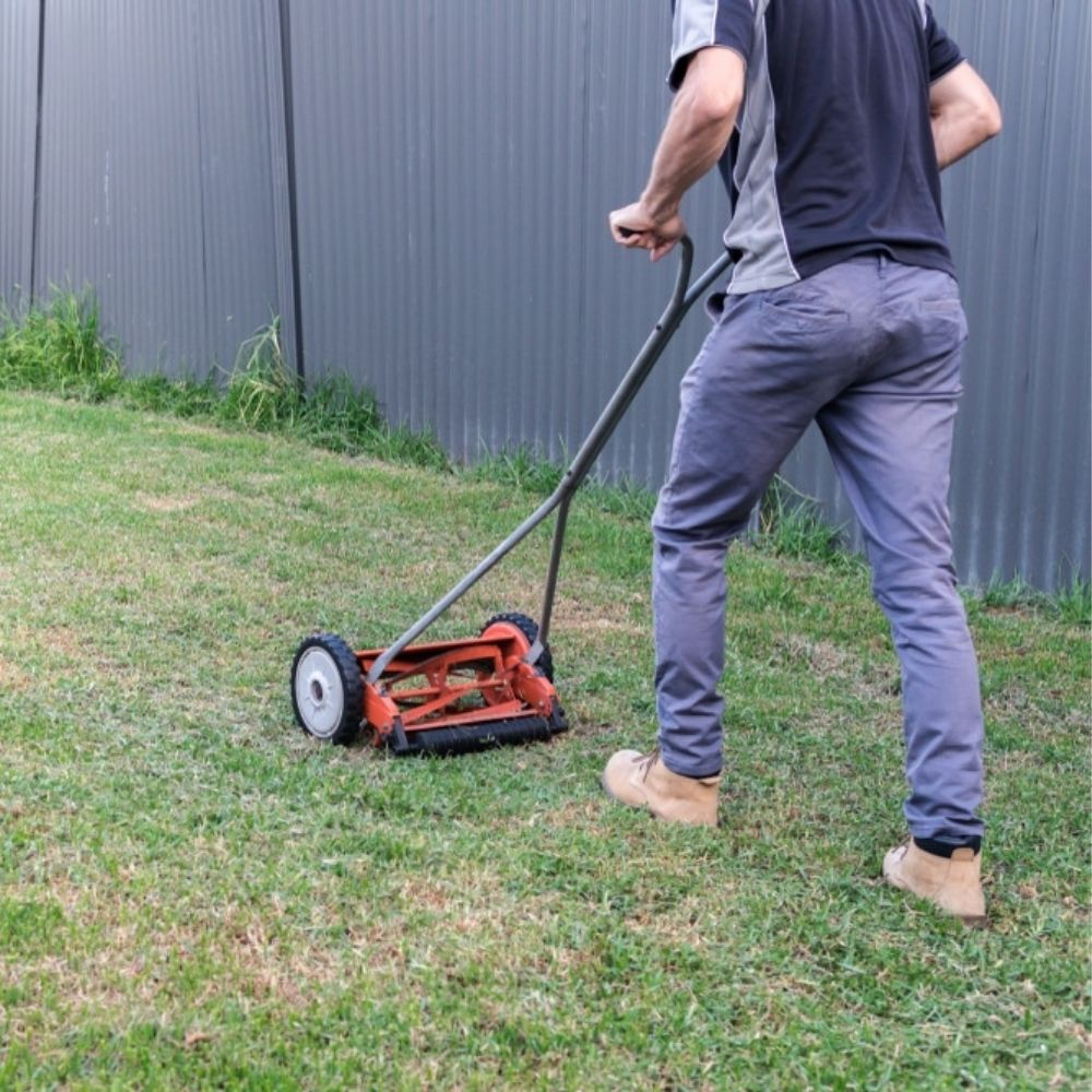 This Man Mowing The Lawn