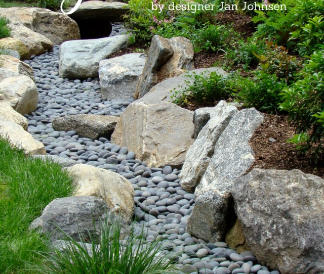 A Dry Stream Is A Landscaping Design That Looks Like A Decorative Garden Feature Even Though It Is Also A Practical Solution To Garden Runoff