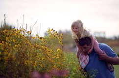 Girl-sitting-on-her-father-s-shoulders-looking-at-the-Glasshouse-Borders-at-RHS-Garden-Wisley-_MAR0009581