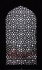 Intricately carved stone window screen
