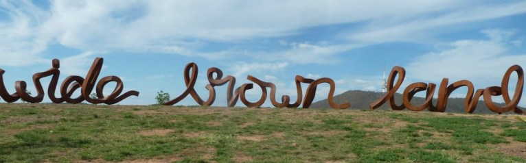 Wide Brown Land sculpture at National Arboretum ACT