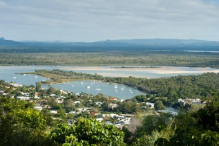 Noosa panorama with an aerial view over the estuary and basins of the Noosa River in Queensland and the resort town nestling amongst tropical foliage on its banks