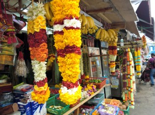 Flower stall selling garlands for temple offerings in Little India, Singapore