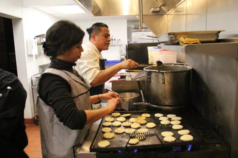 Marlene making gorditas from yucca flour while Neftali stirs the posole. Photo by Elizabeth Hoover